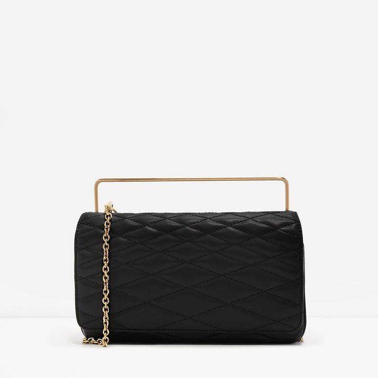 663c29d07e899 Gorgeous Soft Leather Small black clutch bag featuring a quilted texture  design. Carry it using the top metallic ... Michael Kors ...