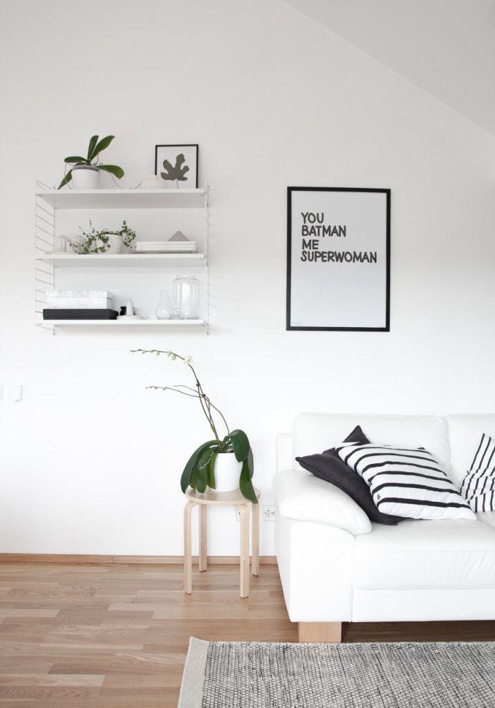 Scandinavian living room. White walls, white sofa, String shelf. from Decordots blog