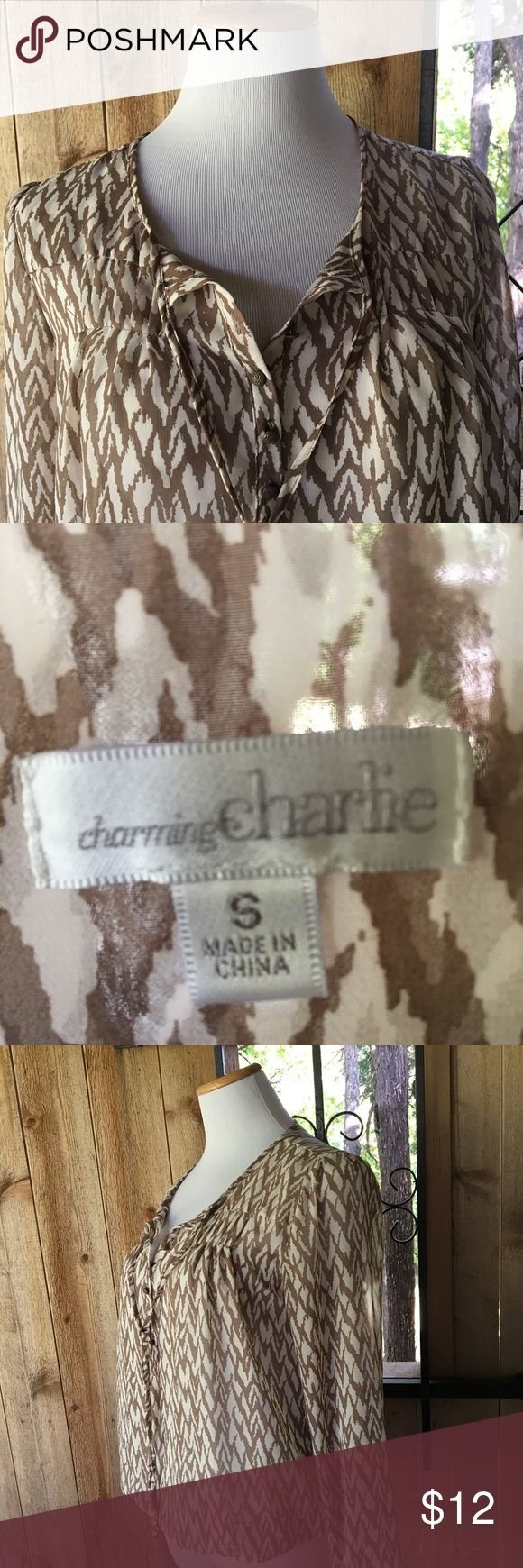 Charming Charlie white and tan shirt Gathers at the bottom, sheer, cream and tan chevron Charming Charlie Tops Blouses