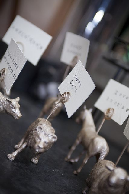 nice! dollar store animals + wire + spray paint = labels for food table   from off beat bride