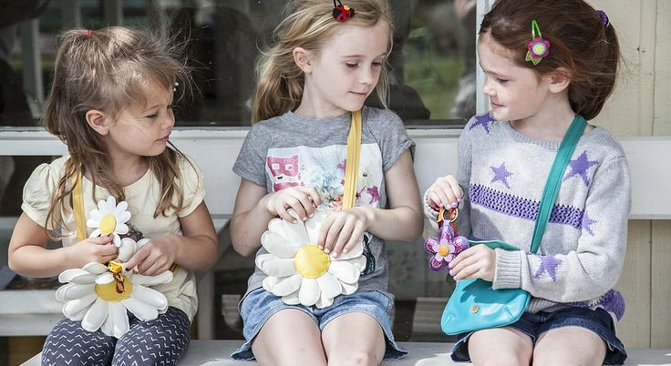 Little girls dress up and play with our handmade bags and Hairclips visit www.kalisa.com.au