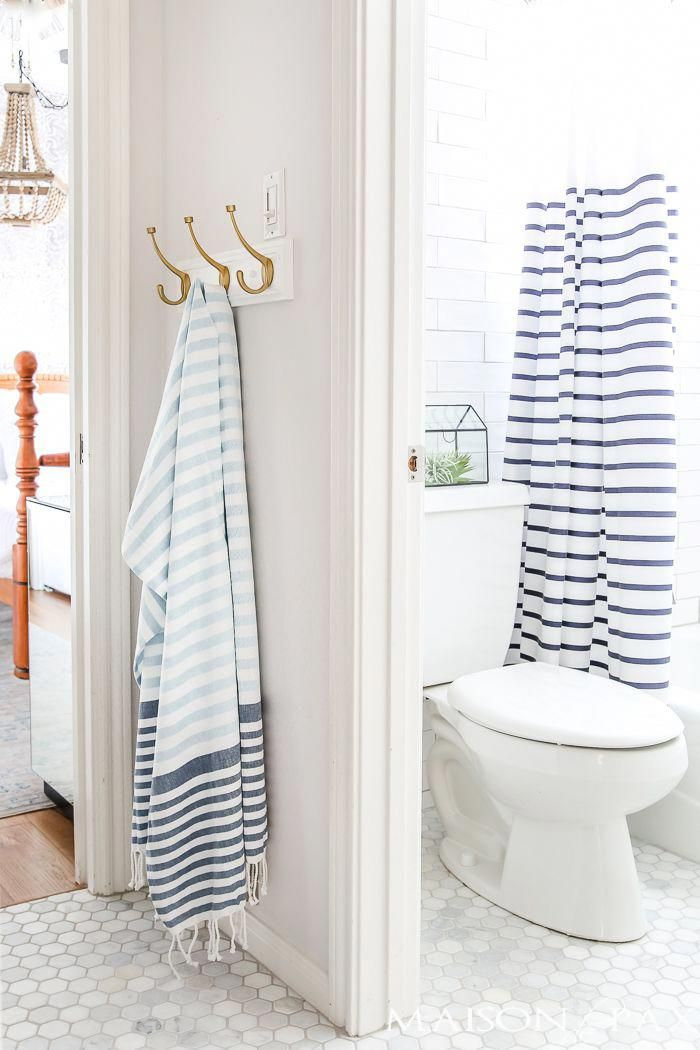 Blue And White Striped Turkish Towels And Shower Curtain Give This