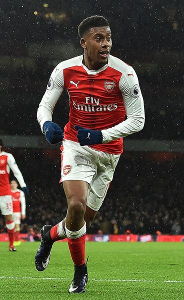 Arsenal's Nigerian striker Alex Iwobi celebrates scoring his team's second goal during the English Premier League football match between Arsenal and Crystal Palace at the Emirates Stadium in London on January 1, 2017.  / AFP / Glyn KIRK / RESTRICTED TO EDITORIAL USE. No use with unauthorized audio, video, data, fixture lists, club/league logos or 'live' services. Online in-match use limited to 75 images, no video emulation. No use in betting, games or single club/league/player publications…