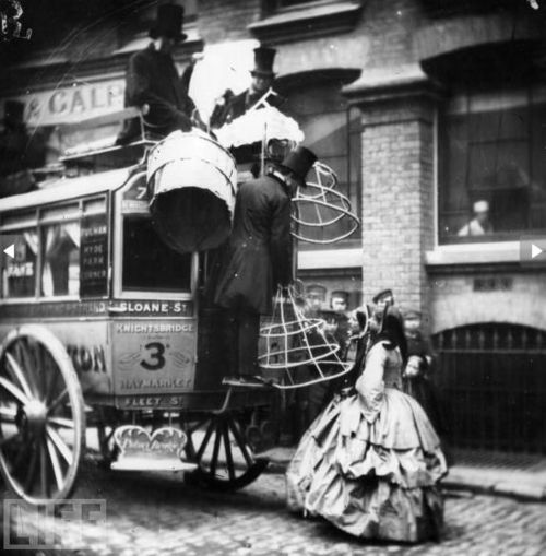 hoops had to be removed before taking your seat in a carriage and then they were hooked onto the back of the carriage