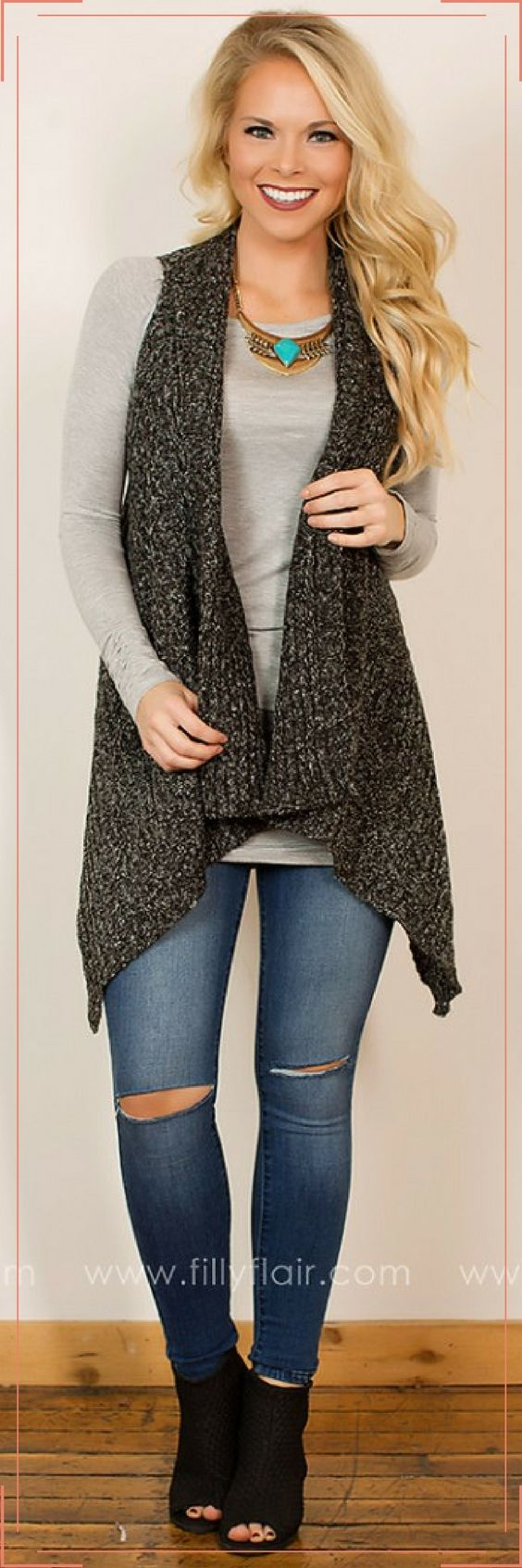 Looking for the perfect versatile cardigan? This heathered gray sleeveless cardigan pairs nicely with a variety of different outfits and makes for a great layering piece!