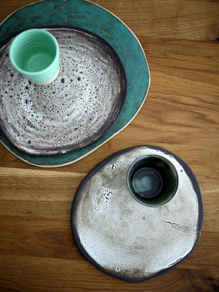 collection of rusty handmade ceramic plates, tableware, dinnerware, irregular shapes, grey, off white, green colours