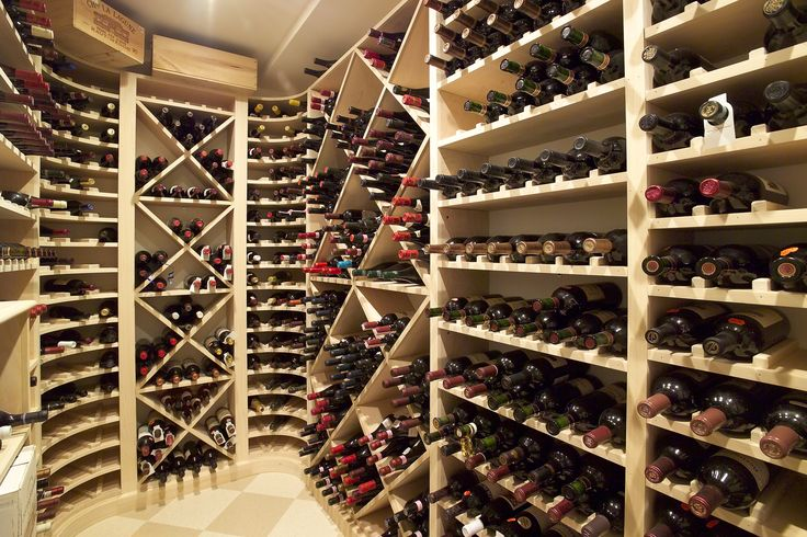 Wine cellar in shingle style home.