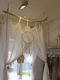 Hang cheap curtains from branches to make a hideaway
