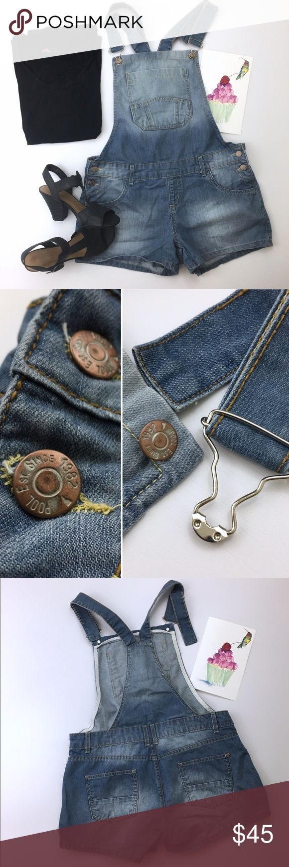 """Lady's Denim Short Overalls Preowned. Like New condition!  •women's Jean Shortalls •Waist: 34"""" •out seam: 11"""" •shoulder strap can be adjusted •Front length: 22"""" Jeans Overalls"""