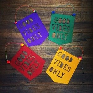 Good Vibes Only. Super fun stiffened felt flag. Lasercut Felt flag with pom poms detail and neon waxed cord. Ready to hang. Approx 20cm wide x 24cm Tall. Exclusively made for Little Shop!Please Note: Due to the handmade nature the Pom Pom colours will be random for each flag - we make the as gender neutral as possible  - you wont be disappointed :) Made in Little Shops Melbourne Studio. http://littleshopof.bigcartel.com/product/good-vibes-only-felt-flag