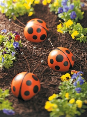 DIY project: bowling ball bugs. Also bumblebees. Could use cheaper gazing balls