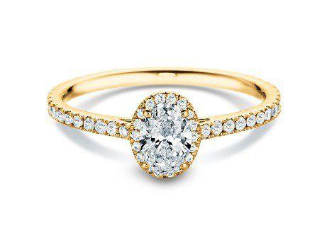 Diamantring Pure Emotion in 18K Gelbgold mit Diamant 0,93ct.  Der oval geschliffene Diamant bildet mit seiner eindrucksvollen Größe von einem halben Karat das strahlend leuchtende Zentrum dieses üppig mit Diamanten besetzten Gelbgoldrings. Selbstbewusst erhebt er sich über die ihn umrahmenden Diamanten und verleiht diesem liebevoll gefertigten Ringmodell den besonderen Charme, der zeitlosen Klassikern vorbehalten ist.