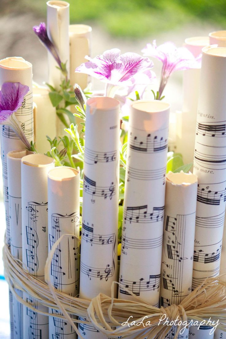 Music Centerpieces    Take a large metal can and roll sheets of music on glue on the can. You can put either fresh cut flowers or plant some in the container.