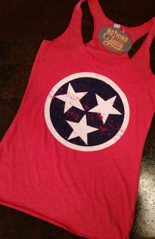 This tri-blend, racer-back ladies tank top is ultra soft and available in Vintage Red with the TN tri-star from the state flag printed in blue & white. $27.95 XS-XL. #nothingtoofancy