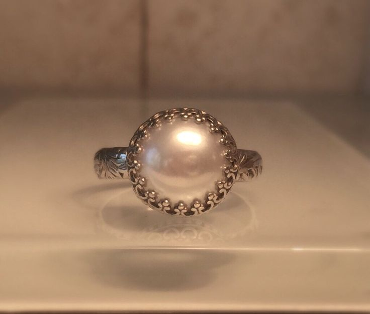A personal favorite from my Etsy shop https://www.etsy.com/listing/512771913/pearl-crown-ringhandmade-pearl-and