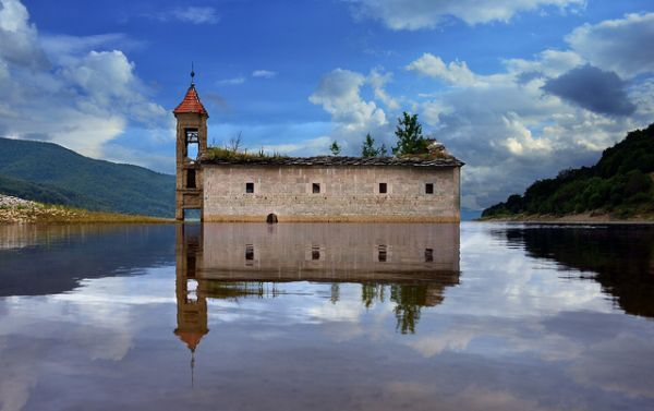 Submerged church, Mavrovo Lake, Macedonia. The abandoned church of St Nicholas was reportedly the victim of an artificial lake created to supply water to a local power plant.