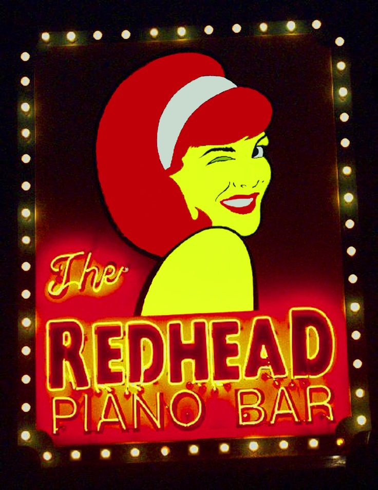 The Red Head Piano Bar in Chicago. Took the pic and Photoshopped the heck out of it. I jacked up the saturation and airbrushed coloration. I also cloned the bulbs so they were all lit.