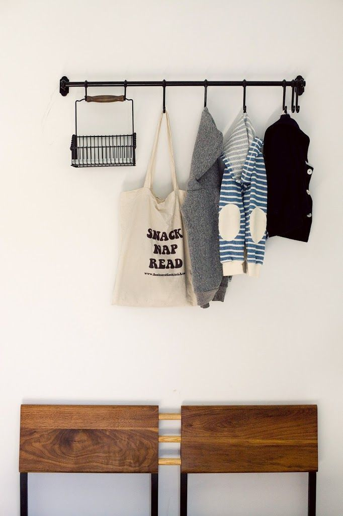 While most people use IKEA's Ikea Fintorp hook and rail system for kitchen storage, you can also create a space for bags and coats in the entryway without taking up tons of space.