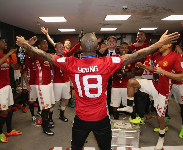 Ashley Young of Manchester United celebrates in the dressing room after the EFL Cup Final match between Manchester United and Southampton at Wembley...