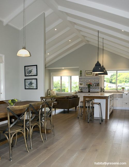 Glen and Sara wanted a subtle, neutral colour with green undertones for the kitchen and living room to tie in with the kitchen's splashback tiles. They chose Resene Half Linen, with Resene Rice Cake on the trims and ceiling. Picture by Jessica Judge.