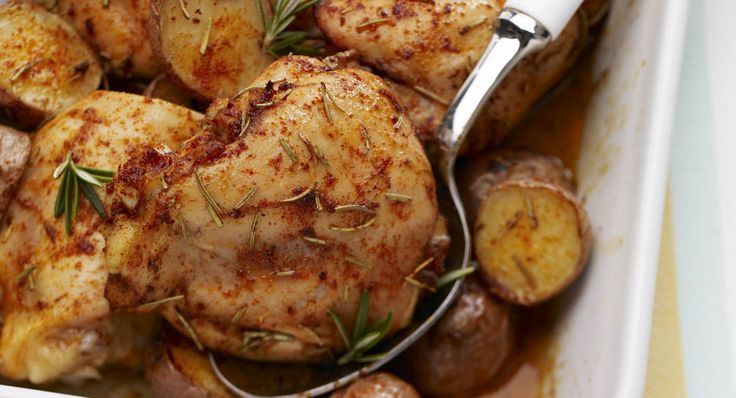 """Rosemary Baked Chicken with Potatoes - I usually add sweet potatoes, butternut squash, carrots and/or parsnips to the """"potatoes"""" when I make this.  I also coat the veggies separately from the chicken, because it's easier.  I also leaves the skins on because YUM.  :)"""
