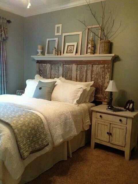 Rustic Bedroom Decor / Rustic Mantel headboard - love the branches and the mattes/frames on and against the wall. Lovely vibe. #rustic bedroom decor