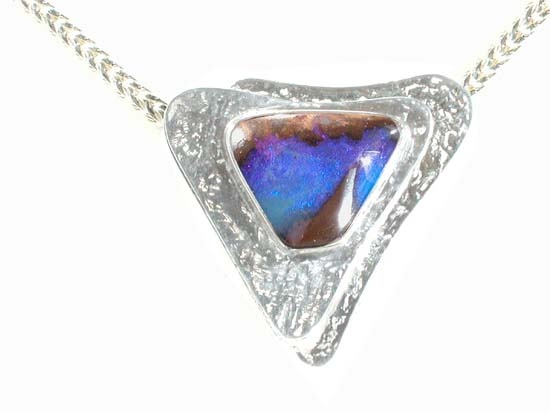 Sterling silver pendant with boulder opal. Design: Ailin Roelvaag.