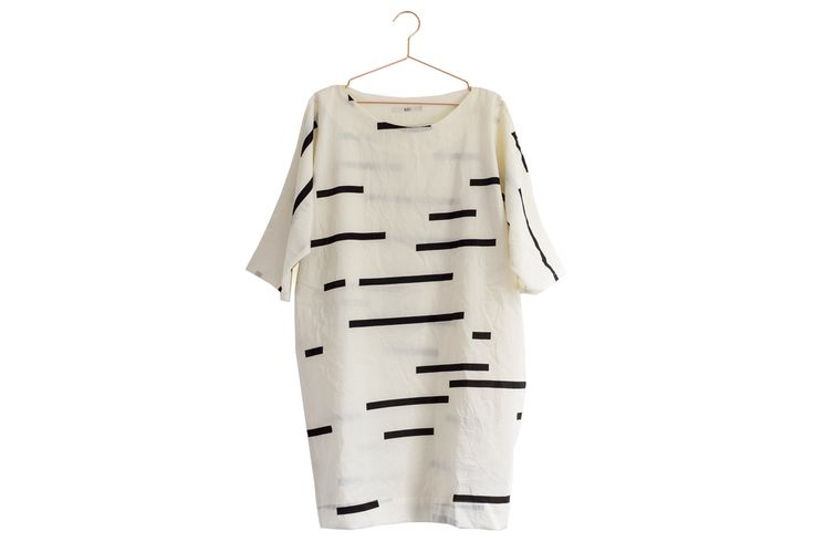 """The Now Dress from UZI is universally flattering with its mix of oversized styling and geometric prints!UZI's signature fabrics have a slightly crinkled effect, which makes their pieces perfect for travel. Toss it on and go!Dimensions: Small: Length measures 34"""". Shoulder to shoulder measures 27""""..."""