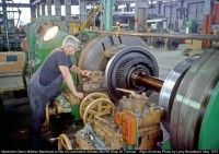 Railpictures.ca - Larry Broadbent Photo:   Machinist Glenn Mildren turns a pair of Locomotive Wheels in the MCRR Shop in St Thomas. When making the rough cuts of 3/8 of an inch with a Carbide Cutter this Machine would send vibrations that could be felt through out the shop.The cuttings would come off Red hot and looked like heavy duty Truck Coil Springs. | Railpictures.ca – Canadian Railway Photography – photographie ferroviaire Canadienne.