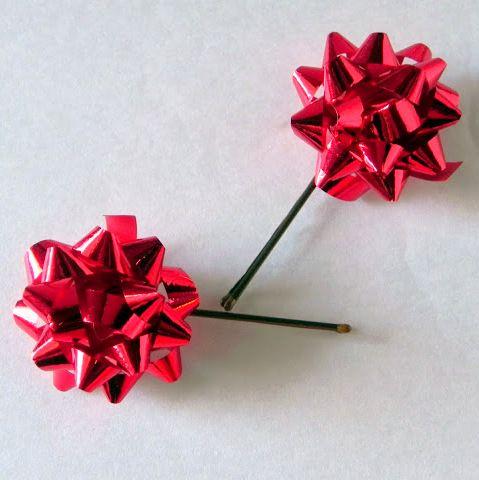 Christmas DIY hair decoration for girls: Push a bobby pin through a wrapping bow and place in hair.