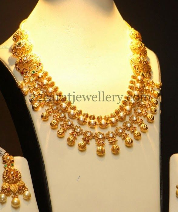 Jewellery Designs: Pearls and Polki Layers Gold Set