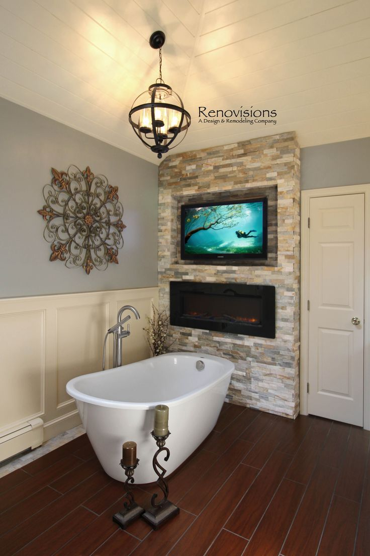 The 25 best free standing electric fireplace ideas on for Tv in bathroom ideas