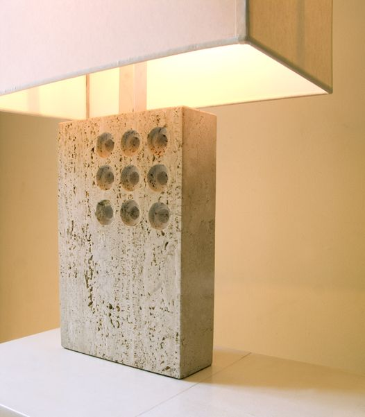 Italians modernist made some very lovely travertine stone objects like this 1960's lamp. Understated but the 9 circular holes add just the right amount of design interest to the piece.