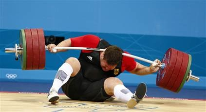 Germany's Matthias Steiner is injured Aug. 7 as he drops a 432-pound barbell during the men's +150kg Group A snatch weightlifting competition at the ExCel venue during the London 2012 Olympic Games. (Grigory Dukor / Reuters)