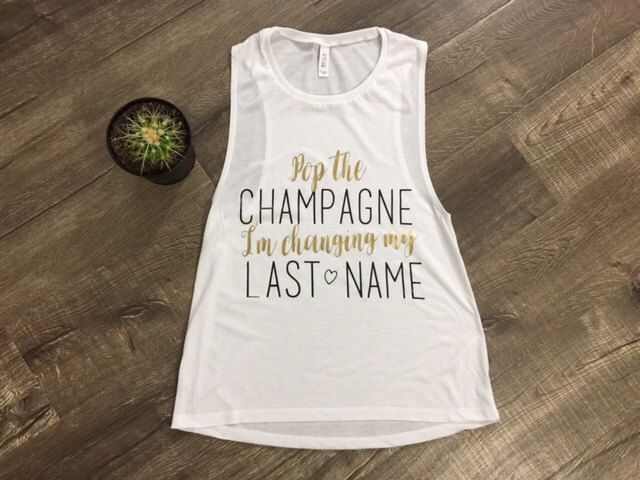 Pop the Champagne I'm Changing My Last Name Muscle Shirt Bride Tshirt Bachelorette Tank Flowy Muscle Tee Married Wedding Bridal Shower Cute by TheTeeStudio on Etsy https://www.etsy.com/listing/494417100/pop-the-champagne-im-changing-my-last