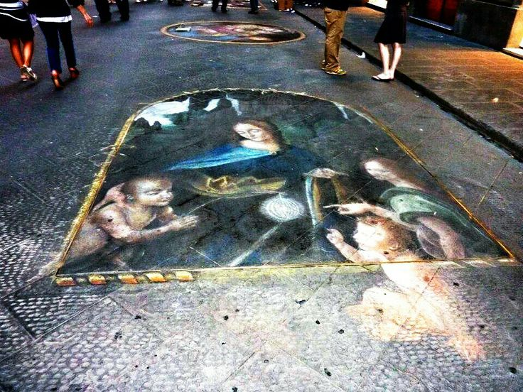 Florence chalk art on the streets at night