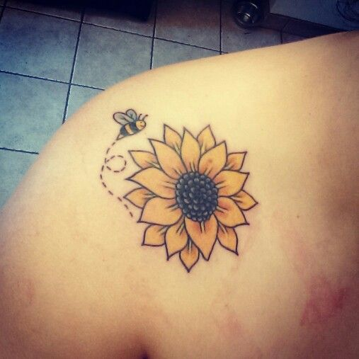 Sunflower tattoo. This is cute, but I'd put it on my foot :)
