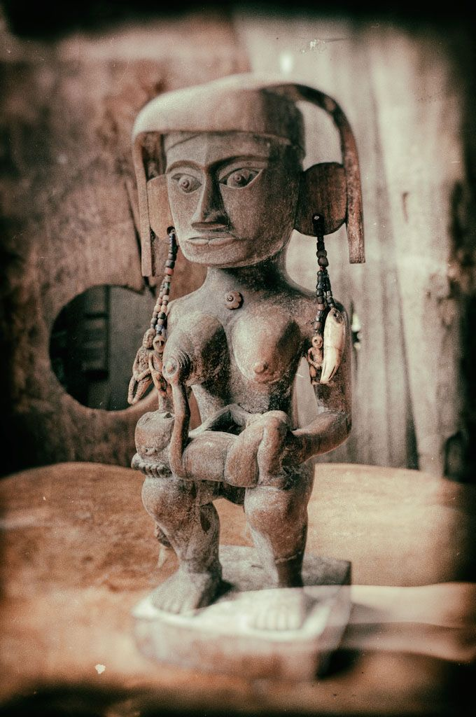 Indonesian Batak woodcarving of mother and breast-feeding child with mammoth ivory amulets © 2016 Bali Charm