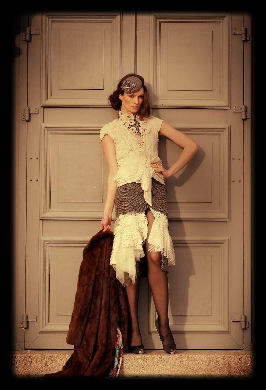Karen Fitzpatrick, wearing a Wool tweed lace embellished skirt (€180) with cream lace and cotton embellished blouse with cap sleeve (€160), grey pinstripe wool felted head piece (€79) and black lace necklace with cream felted flowers (€110) by Bonzie Design