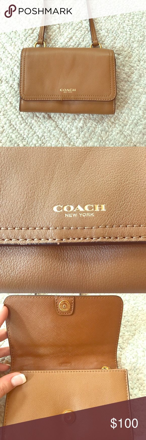 Gently used coach cross body purse Very gently used with no visible signs of wear. Bought this from the coach store and used it for a week straight on a trip to France. Haven't used it since. Leather is broken in but no scratches or marks are evident.  Long strap for crossbody handling and lots of little pockets. Coach Bags Crossbody Bags