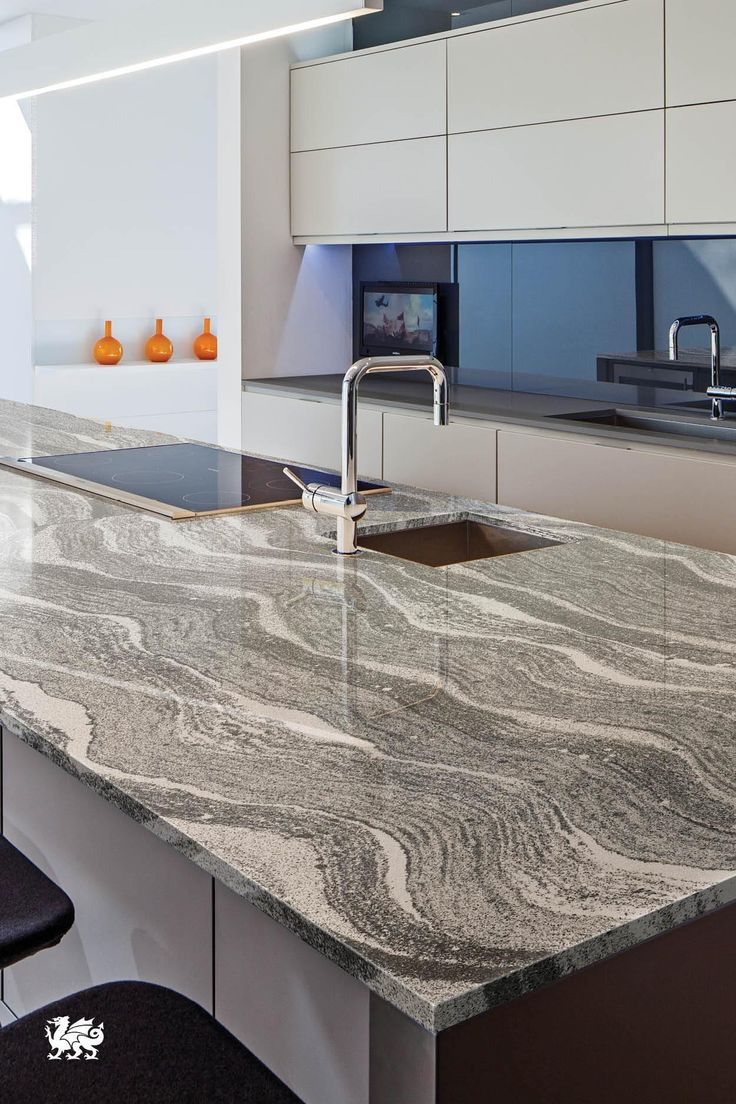 Gray Countertop Materials : sleek, a Roxwell? island presents elegant serpentine swaths of gray ...