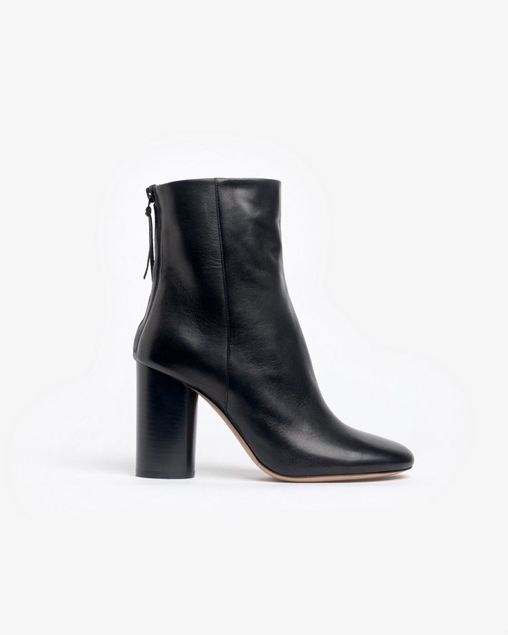 Effortlessly cool and feminine boots feature smooth lab leather exterior  and lining, zip back closure with long tassel, stacked wooden cylindrical  heel, ...