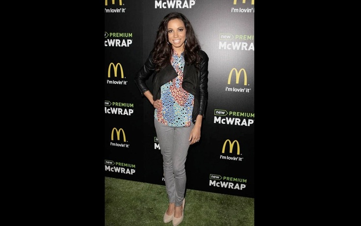 Recent movie temptress Jurnee Smollett toned it down at the McDonald's McWrap Launch Party in grey skinny jeans, a printed top and leather jacket.