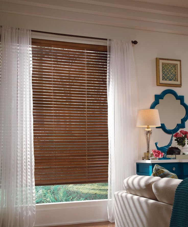 This Electric Dcor Features Our ParklandR Wood Blinds From Hunter Douglas Traditional Or Rustic