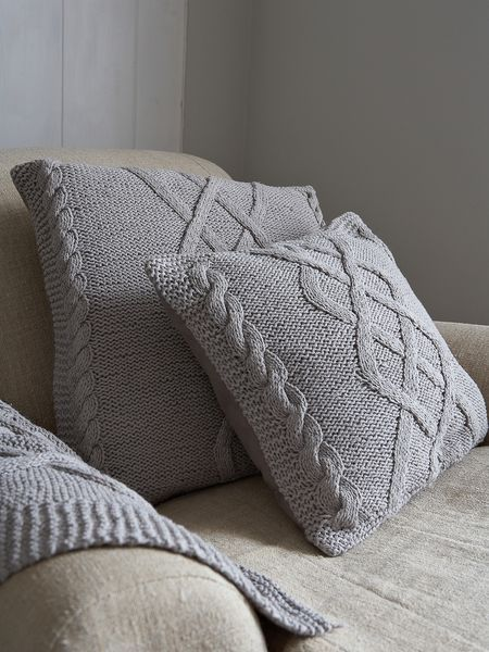 I would prefer these to be made with chunkyer yarn.. Cable Knit Cushion - Scandinavian Grey http://www.nordichouse.co.uk/cable-knit-cushion-scandinavian-grey-p-1051.html