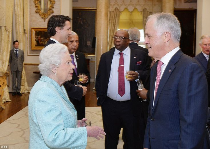 Queen Elizabeth II talks to Australian Prime Minister Malcolm Turnbull (right) during a He...