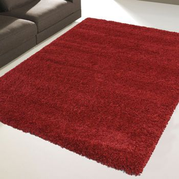 I love the cream one for our living room - Costco: Majestic Shag Polypropylene Rug Collection