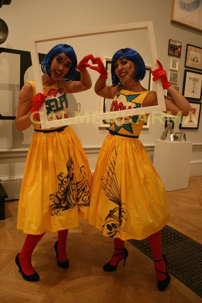 Superheroes themed walkabout photo frame with our Pop Art Pair - perfect to capture all those guests with your party superhero characters Tel:  0203 602 9540