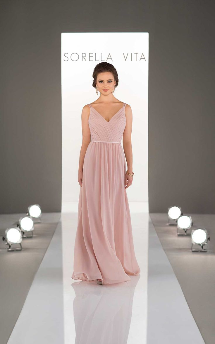Featuring a classic, pleated v-neck and skinny double straps, this chiffon gown is the perfect way to show off your bridesmaid's shoulders and décolletage. Its floor-length chiffon skirt is accented with a coordinating satin waistband, making this style flattering on all shapes. Also available in cocktail length as style 8613.