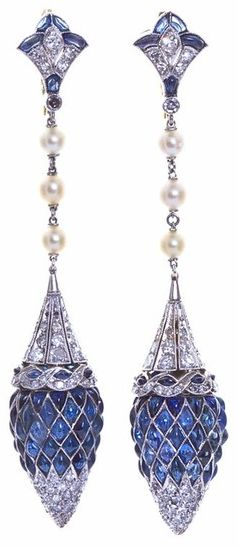 Art Deco Diamond Sapphire Dangle Earrings. France. Absolutely magnificent Deco design. Dangling diamond and sapphire inlaid platinum earrings with pearl strands. Deco styled diamond and sapphire fleur-de-lis top connects to a gorgeous diamond and platinum conical cap edged with diamond swirl border with a pointed acorn shape formed from sixty marquise and pear shaped cabochon cut sapphires tipped with a delicate diamond melee point swiveling beneath. For pierced ears. Via 1stdibs.